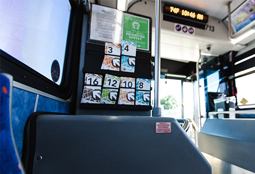 Inside the bus and a view of route options placed on an announcement board
