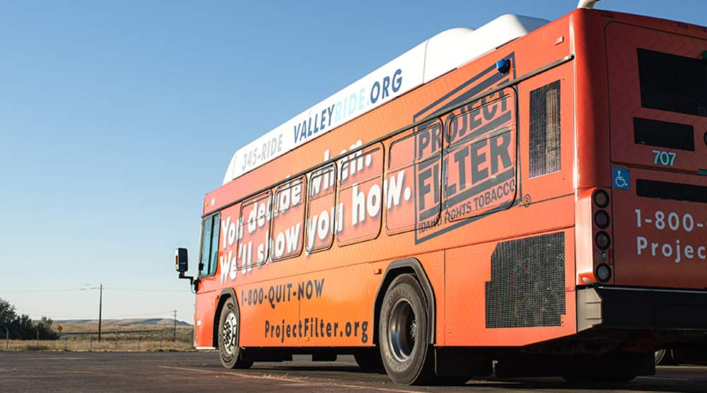 bus fully wrapped in advertising in boise
